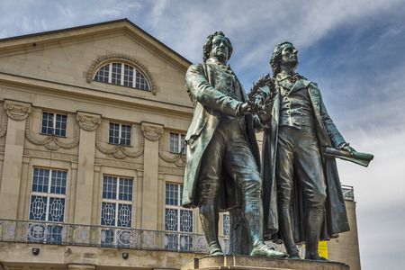 Monument of the famous german writers Goethe and Schiller in Weimar, Germany 報道画像