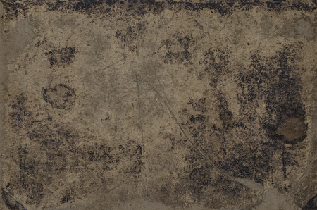 bookcover: grungy texture of a vintage bookcover with stains, scratches and wrinkles