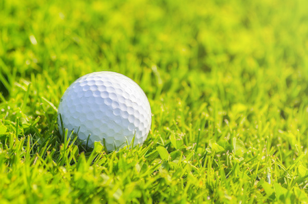 shot: golf ball on course ready to be shot