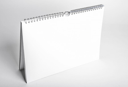 spiral binding: white blank calendar mockup with spiral binding seen from above