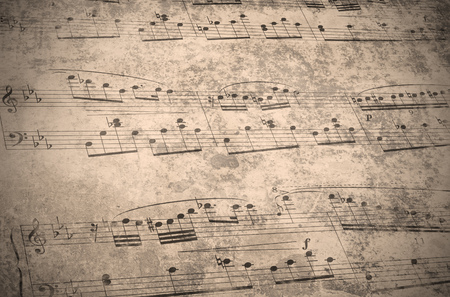 antiqued: vintage music notes with stains, scratches and wrinkles Stock Photo