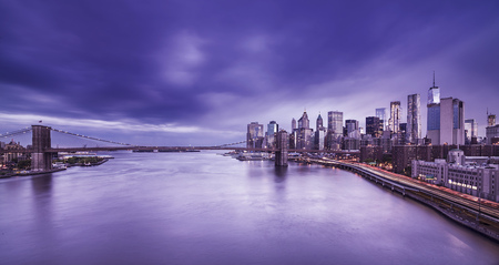 long: Brooklyn Bridge with Manhattan Skyline at dusk, New York City, long term exposure Stock Photo