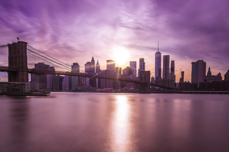 Manhattan Skyline with Brooklyn Bridge in front at dusk, New York City, long term exposure