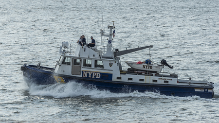 NEW YORK CITY, USA, MAY 18, 2017: American police boat (N.Y.P.D) patrolling   on the Hudson River