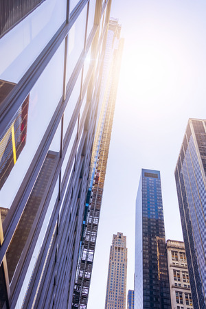 mirror: low angle shot of modern glass and steel office towers in Manhattan financial district, New York City Stock Photo