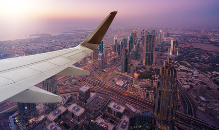 aerial view of Dubai seen from an airplane with wing in front 스톡 콘텐츠