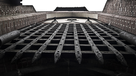 portcullis entrance of a medieval castle seen from below