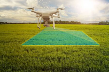 UAV drone multicopter flying with high resolution digital camera over a crops field, agriculture concept Reklamní fotografie