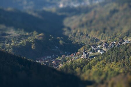 aerial view over a small village in the black forest with intentional tilt-shift blur