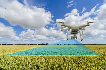 UAV drone multicopter flying with high resolution digital camera over a crops field scanning for problems, agriculture concept