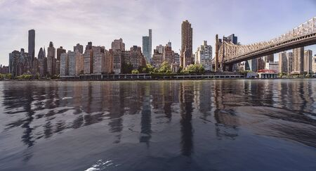New York City Skyline seen from Roosevelt Island with East River in front