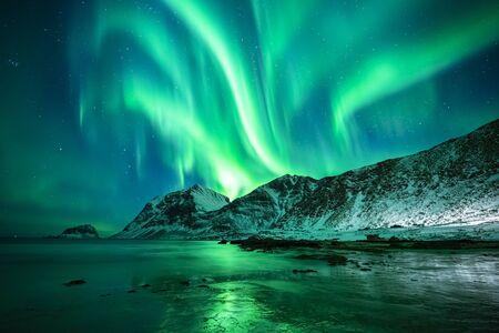 beautiful northern lights over winter sea and mountain scene, lofoten, norway