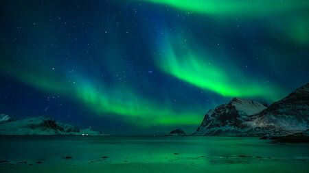 beautiful northern lights over winter mountain scene in the evening, lofoten, norway Reklamní fotografie