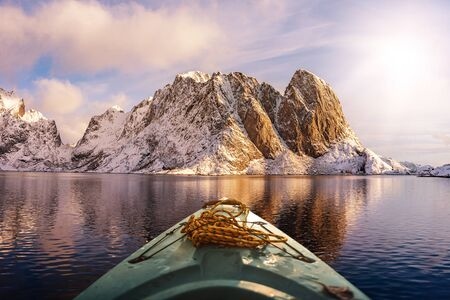 kayak on a lake near snow capped mountains in norway, scandinavia Standard-Bild