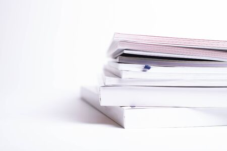 stack of different broshures and books isolated on a white background Reklamní fotografie
