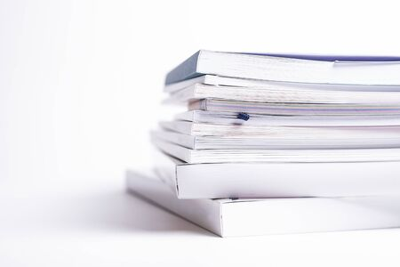 large stack of different broshures and books isolated on a white background Reklamní fotografie