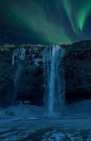 scenic Waterfall with Northern Lights and clear starry sky, Iceland