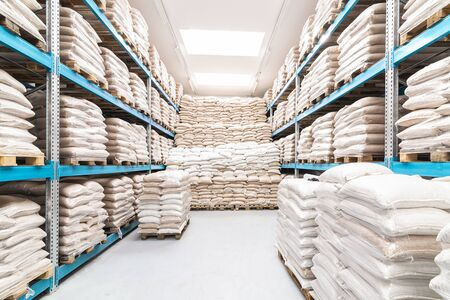 clean and open warehouse stacked with white sacks