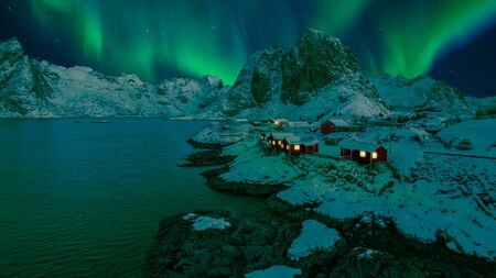 beatiful northern lights over the village of Hamnoy on the lofoten islands, norway