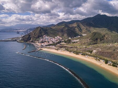 Aerial view of the famous white sand beach Playa de Las Teresitas with scenic San Andres village. Tenerife, Canary Islands, Spain