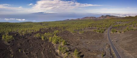 Aerial view of Chinyero Forest with ocean and La Palma Island in the back, Tenerife, Canary Islands, Spain