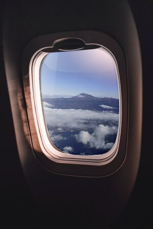 aerial view of Tenerife with Teide volcano, part of the canary islands, spain, seen through an airplane window