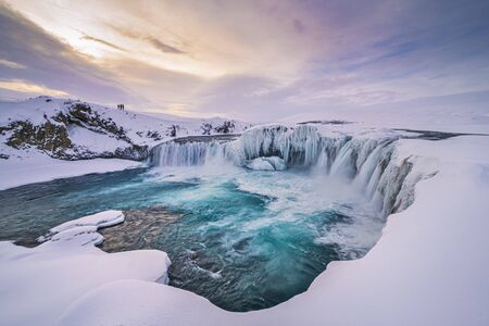 Incredible winter sunrise scenery of powerful Godafoss waterfall with dramatic sky, Iceland Reklamní fotografie