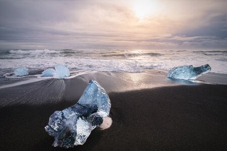 glacier Ice on the black volcanic beach called diamond beach near Jokulsarlon glacier lagoon, winter Iceland Reklamní fotografie