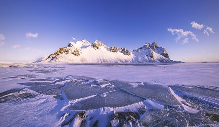 Vestrahorn Mountains on Stokksnes cape with ice floes in front, beautiful winter morning scenery, Iceland