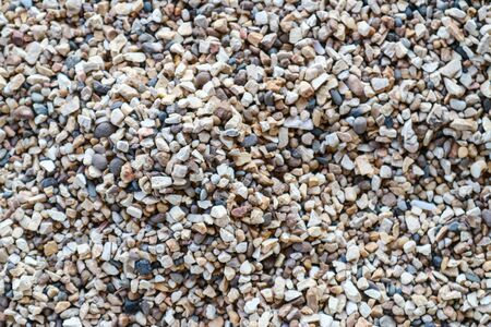 dry small river gravel with beautiful and colorful object texture for gardening and pathways decoration by close up view