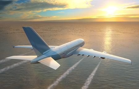 Plane flies over the sea at sunset. Standard-Bild