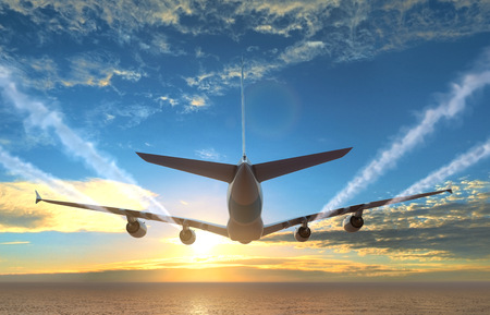 Plane flies over the sea at sunset. photo