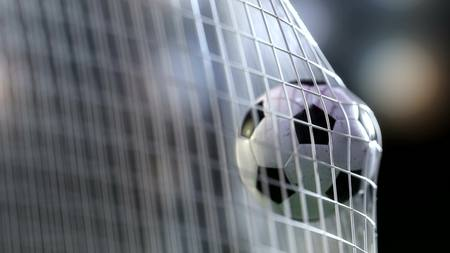 goal net: football ball in the goal net. 3drendering Stock Photo