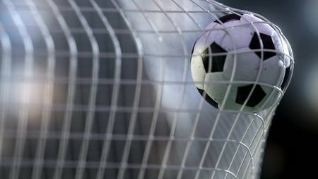 football ball in the goal net. 3drendering Stock Photo