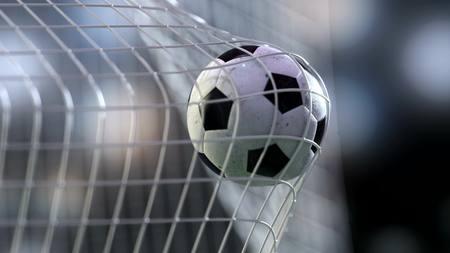 penalty: football ball in the goal net. 3drendering Stock Photo