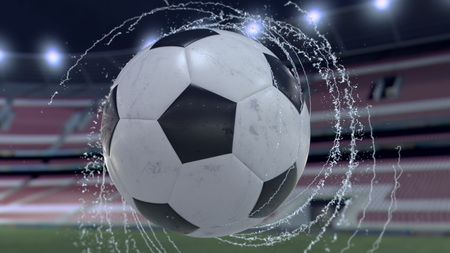 Soccer ball flies emitting whirl of water drops, 3d illustration 스톡 콘텐츠