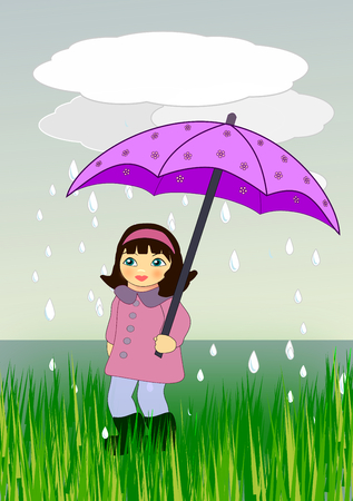 A little girl with an umbrella standing by the sea. photo