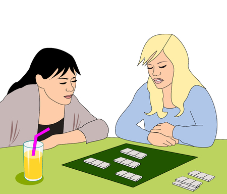 two girls: Two girls sitting at a table playing a board game. Stock Photo