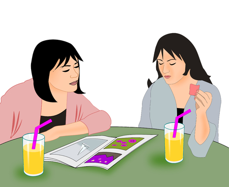 picture book: Two young girl sitting at a table watching in a picture book.