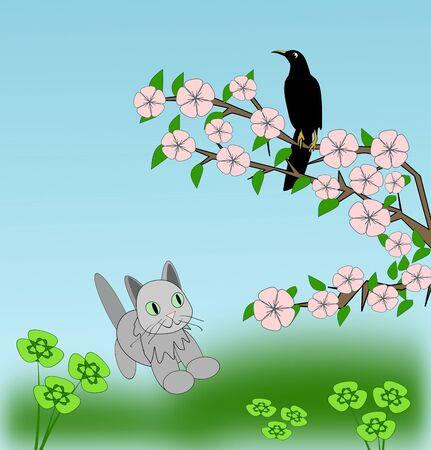 A little cat looking up to a black bird on a branch in blossom.
