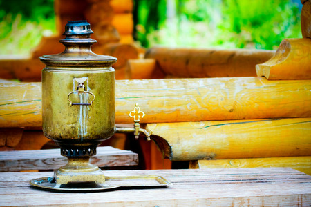 samovar in the wooden house  in the summer photo