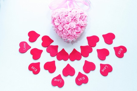 Red paper hearts with pink handmade decoration for wedding celebration for valentine day background Standard-Bild