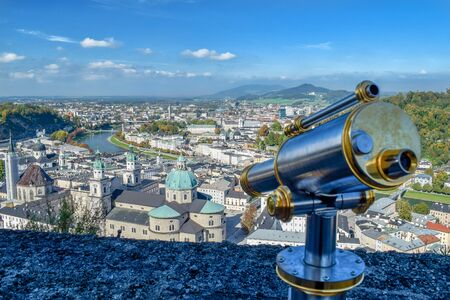 View of old small city from high viewpoint at castle with telescope in Salzburg Austria Stok Fotoğraf