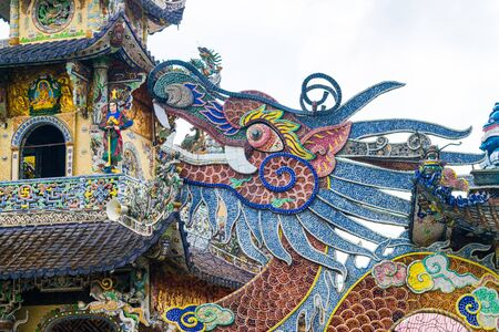 Colorful mosaic of porcelain in shape of dragon in pagoda in Dalat Vietnam 版權商用圖片