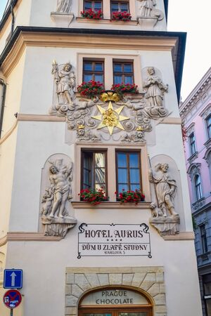 PRAGUE, CZECH REPUBLIC - OKTOBER 10, 2018: The facade of the hotel with flowers on the windowsill and sculptures on the walls.