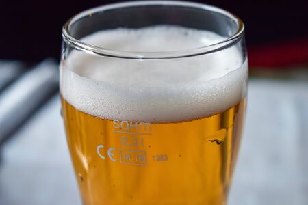 Glass transparent glass with beer with a large layer of foam