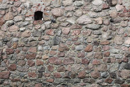 loophole: Vintage stone wall with loophole