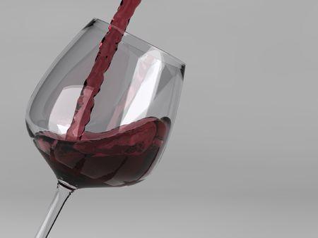 Roter Wein gie�en in Glas