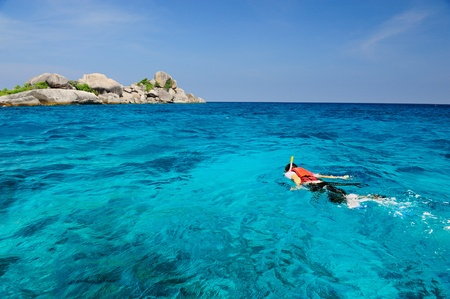 a man snorkling around the island in south of Thailand Stock Photo