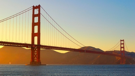 Golden Gate Bridge view from Fort Point in sun set scence, San Francisco  Stock Photo